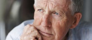 Older retired man with concerned expression on face
